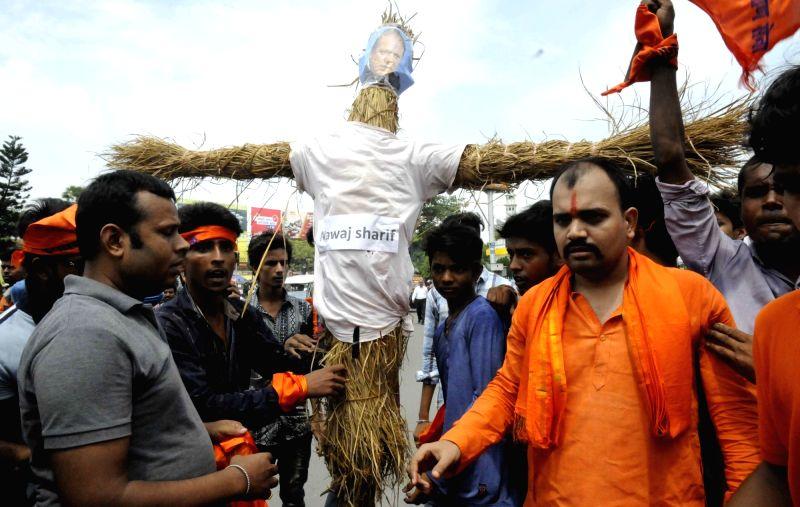 Hindustan Navnirman Sena burn an effigy of Pakistan's Prime Minister Nawaz Sharif in Patna on July 26, 2016. - Nawaz Sharif