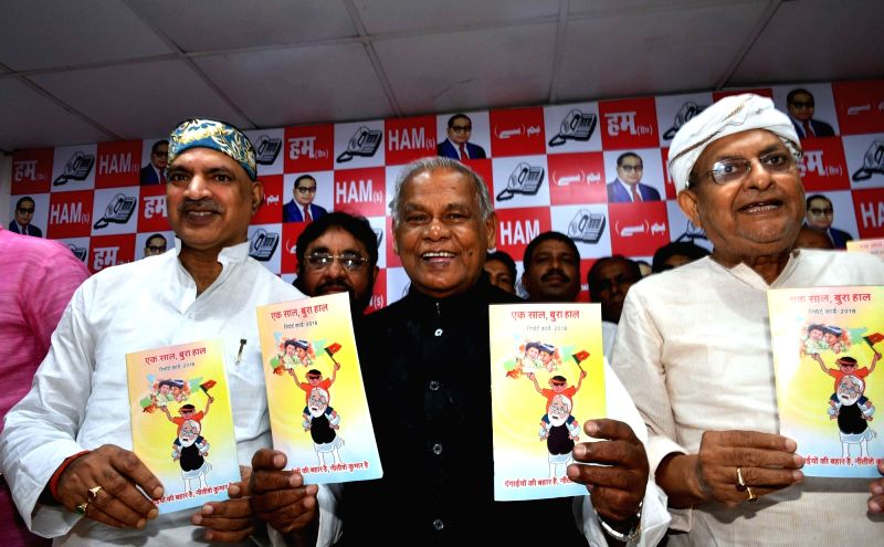 "Hindustani Awam Morcha (HAM) chief Jitan Ram Manjhi releases a report ""Ek Saal Bura Haal"" against the Nitish Kumar led Bihar Government during a press conference, in Patna on July ... - Nitish Kumar"
