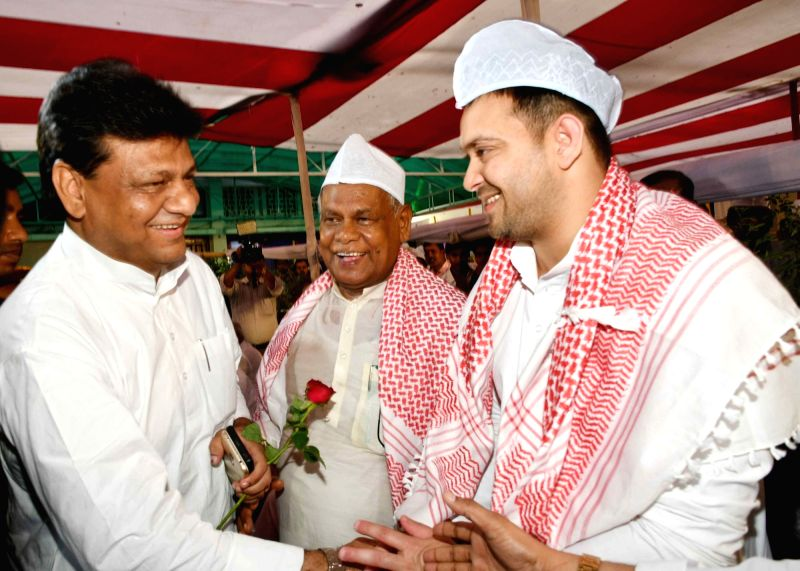 Hindustani Awam Morcha - Secular (HAM-S) chief Jitan Ram Manjhi with Bihar Pradesh Congress Committee (BPCC) working president Kaukab Qadri and RJD leader Tejashwi Yadav during an Iftar party ... - Tejashwi Yadav