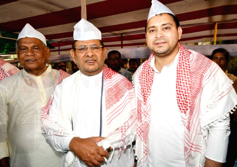 Hindustani Awam Morcha - Secular (HAM-S) chief Jitan Ram Manjhi with RJD er Tejashwi Yadav and Loktantrik Janata Dal leader Sharad Yadav during an Iftar party organised by him, in Patna on ... - Tejashwi Yadav and Sharad Yadav