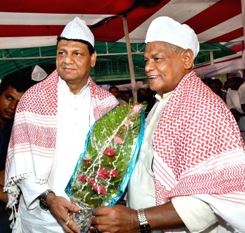 Hindustani Awam Morcha - Secular (HAM-S) chief Jitan Ram Manjhi with Bihar Pradesh Congress Committee (BPCC) working president Kaukab Qadri during an Iftar party organised by him, in Patna on ...