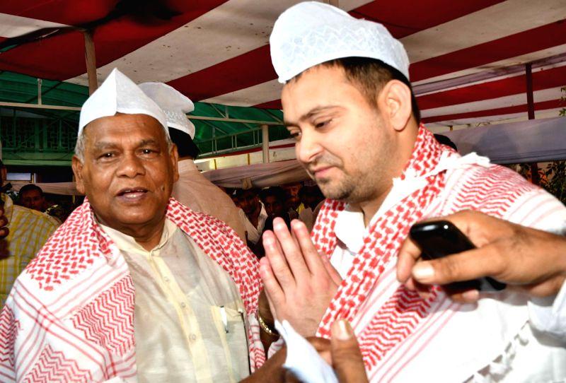 Hindustani Awam Morcha - Secular (HAM-S) chief Jitan Ram Manjhi with RJD leader Tejashwi Yadav during an Iftar party organised by him, in Patna on June 12, 2018. - Tejashwi Yadav