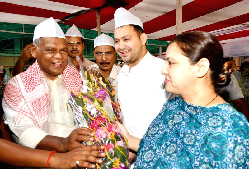 Hindustani Awam Morcha - Secular (HAM-S) chief Jitan Ram Manjhi with RJD leaders Misa Bharti and Tejashwi Yadav during an Iftar party organised by him, in Patna on June 12, 2018. - Tejashwi Yadav
