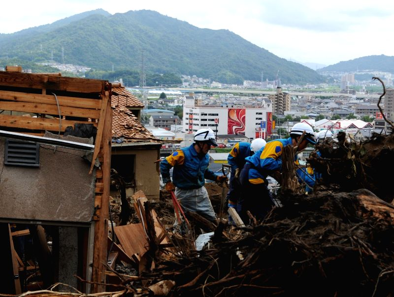 Rescue team members search for survivors following Wednesday's massive landslides in Asaminami Ward of Hiroshima, Japan, Aug. 22, 2014. A total of 39 people were .