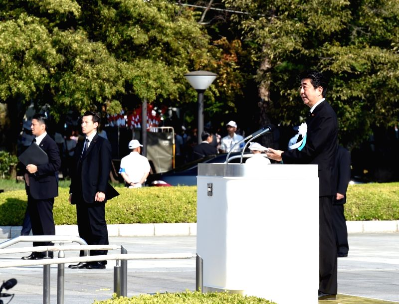 HIROSHIMA, Aug. 6, 2018 - Japanese Prime Minister Shinzo Abe (Front) speaks during a ceremony commemorating the 73rd anniversary of the atomic bombing of Hiroshima at the Peace Memorial Park in ... - Shinzo Abe