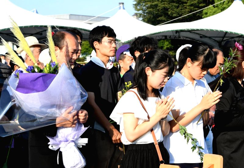 HIROSHIMA, Aug. 6, 2018 - People mourn victims of the atomic bombings at the Peace Memorial Park in Hiroshima, Japan, on Aug. 6, 2018. Japan on Monday marked the 73rd anniversary of the atomic ...