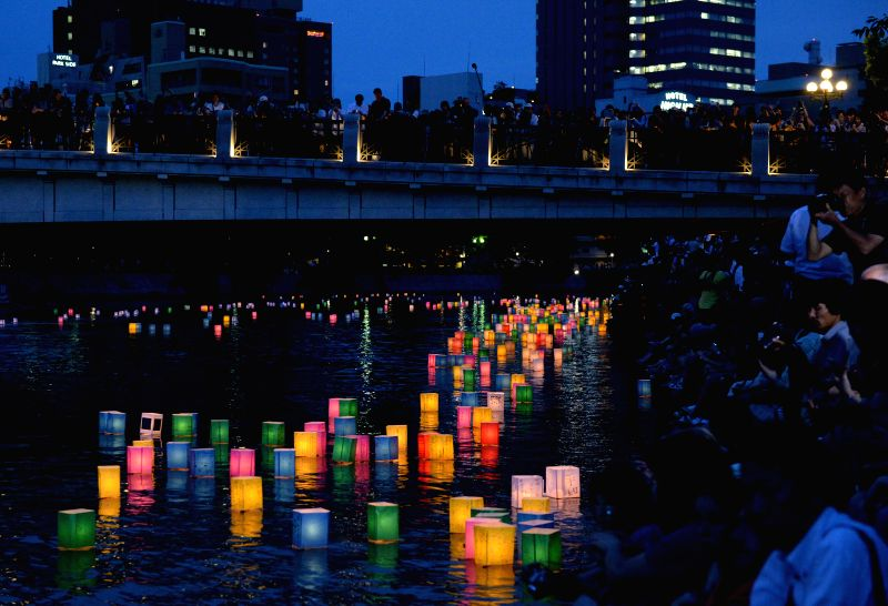 HIROSHIMA, Aug. 6 Paper lanterns float along the Motoyasu River in front of the Atomic Bomb Dome in Hiroshima, western Japan, Aug. 6, 2014. Japan marked the 69th anniversary Wednesday of .