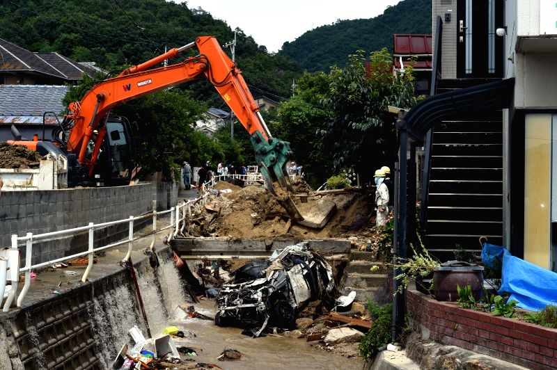 HIROSHIMA, July 11, 2018 - Rescue workers clear mud and debris in Kure, Hiroshima, southwestern Japan, July 11, 2018. The death toll in the wake of torrential rains battering western Japan and ...