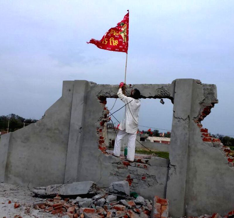 A red coloured flag flutters at the under-construction church that was attacked and vandalised by miscreants in Hisssar of Haryana, on March 16, 2015.