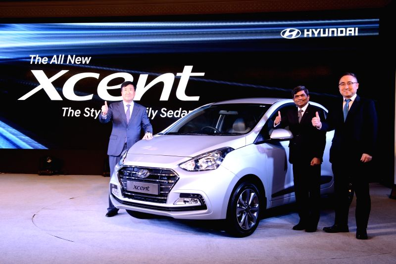 "HMIL MD and CEO YK Koo, Director- Sales & Marketing Rakesh Srivastava and  Director- Sales & Marketing SJ Ha at the launch of ""Xcent"" in New Delhi, on April 20, 2017."