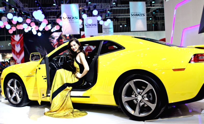 Ho Chi Minh city: A model presents a Chevrolet Camaro car during the Vietnam Motor Show 2014 in Ho Chi Minh city, Vietnam, Nov. 19, 2014. The Vietnam Motor Show 2014, the biggest annual event of the .