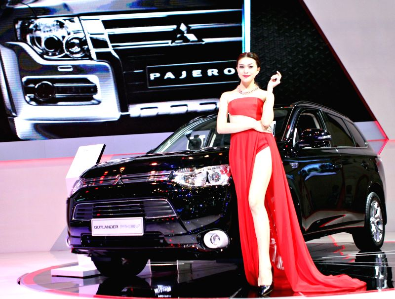 Ho Chi Minh city: A model presents a Mitsubishi car during the Vietnam Motor Show 2014 in Ho Chi Minh city, Vietnam, Nov. 19, 2014. The Vietnam Motor Show 2014, the biggest annual event of the ...