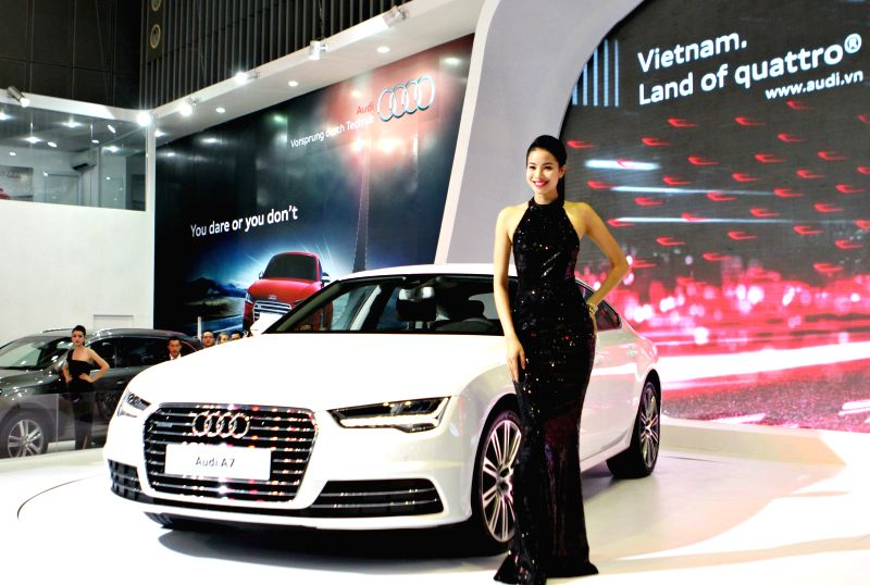 Ho Chi Minh city: A model presents an Audi A7 car during the Vietnam Motor Show 2014 in Ho Chi Minh city, Vietnam, Nov. 19, 2014. The Vietnam Motor Show 2014, the biggest annual event of the ...