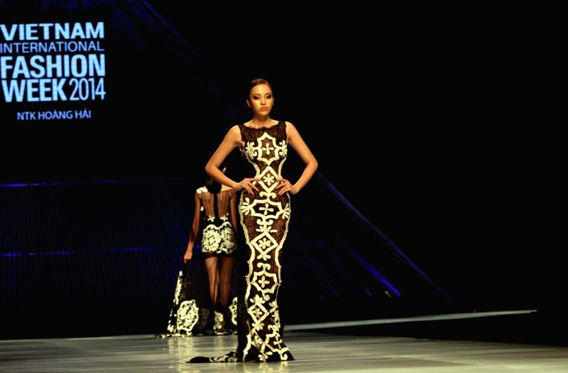 Ho Chi Minh City: A model presents creations of Vietnamese designer Hoang Hai during the Vietnam International Fashion Week 2014 in Ho Chi Minh city, Vietnam, Dec. 2, 2014. (Xinhua/Nguyen Le ...