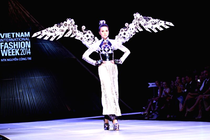 Ho Chi Minh City: A model presents creations of Vietnamese designer Nguyen Cong Tri during the Vietnam International Fashion Week 2014 in Ho Chi Minh city, Vietnam, Dec. 1, 2014. (Xinhua/Nguyen Le ...