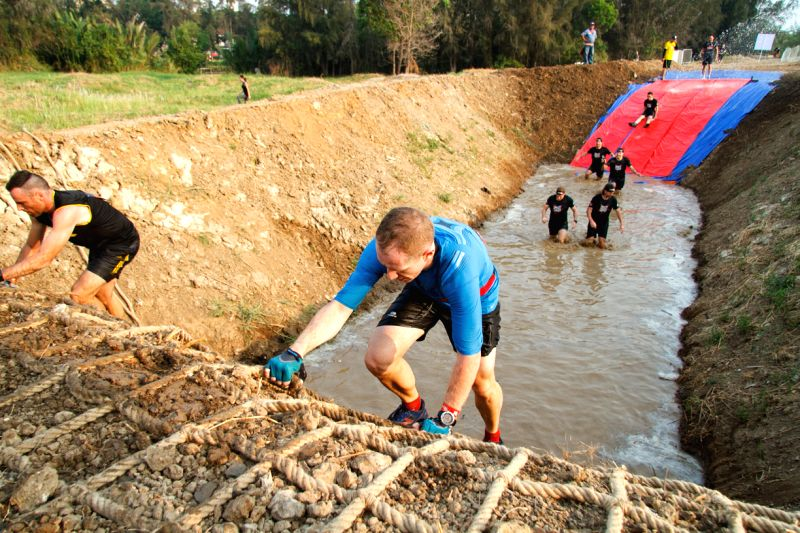 Competitors participate in Dragon Dash, the first obstacle race held in Ho Chi Minh City, Vietnam, April 5, 2015. Dragon Dash consists of a 5-km obstacle ...