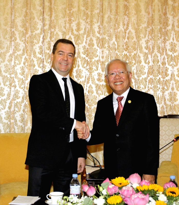 Chairman of the People's Committee of Ho Chi Minh City Le Hoang Quan (R) meets with visiting Russian Prime Minister Dmitry Medvedev in Ho Chi Minh City, ... - Dmitry Medvedev