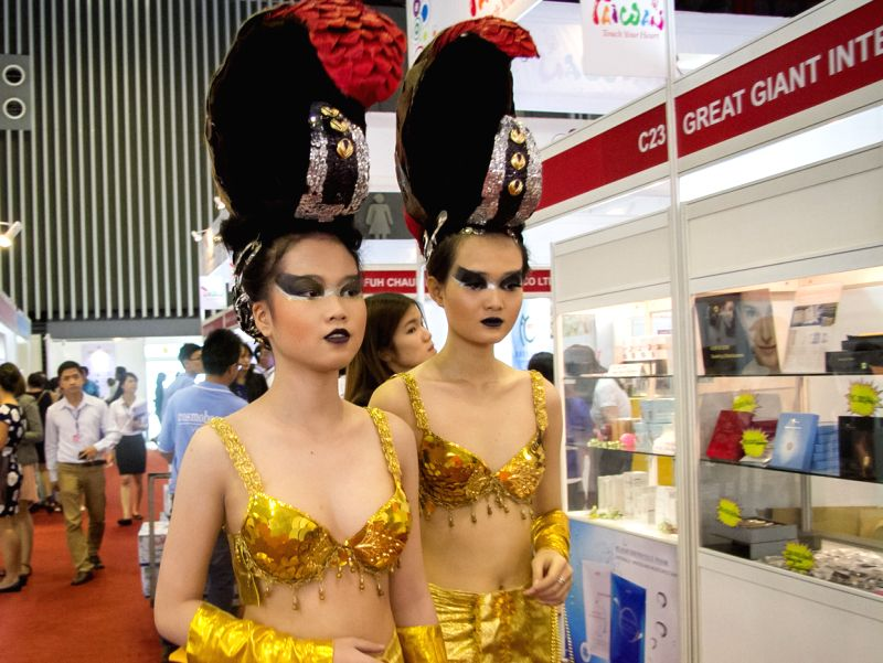 Vietnamese models show their hairstyles during the Vietnam International Exhibition and Conference on Cosmetics, Beauty, Hair and Spa ( Cosmobeaute Vietnam ...