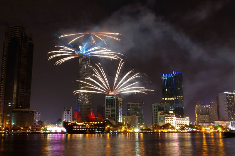 Photo taken on Jan. 1, 2015 shows the firework display in combination with light performance on the New Year's  Eve at the Bitexco Financial Tower in Ho Chi