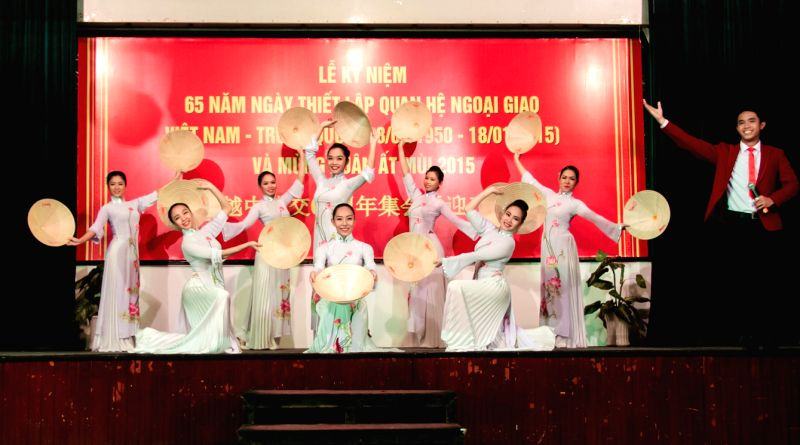 Vietnamese artists perform during an event held by Ho Chi Minh City People's Committee to celebrate the 65th anniversary of the establishment of diplomatic