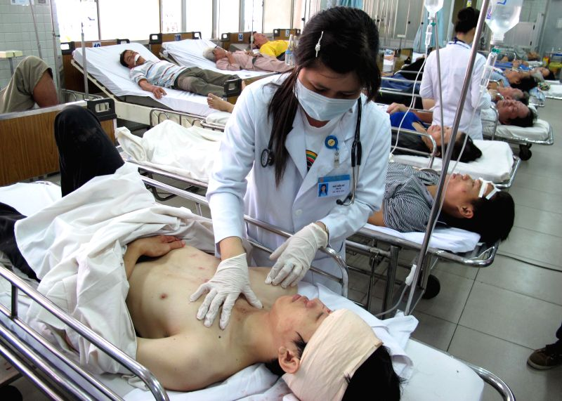 Injured people receive medical treatment in a hospital in Ho Chi Minh City, Vietnam, July 17, 2014. At least 4 people were killed and 8 others injured ...