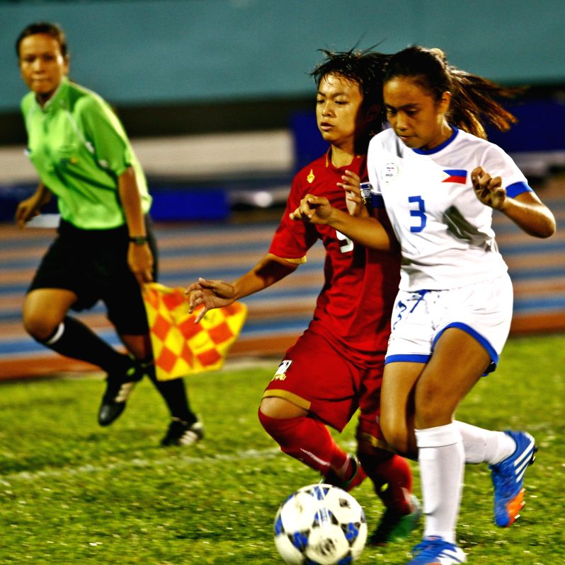 HO CHI MINH CITY, June 16 A player of Thailand(front left) vies for the ball in the final match of the 2014 AFC U-14 Girls Regional Championship (ASEAN) at Thong Nhat Stadium in Ho Chi ...