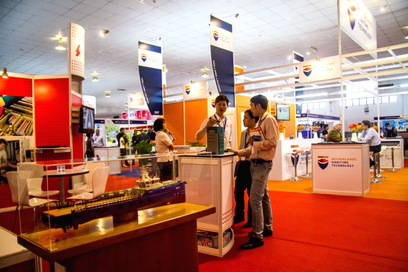 People visit a booth during the International Maritime Exhibition 2015 in Ho Chi Minh City, Vietnam, March 20, 2015.