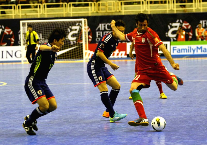 Japan futsal team players(blue) in action with Iran team player(red) on the final match of AFC Futsal Championship 2014,  Ho Chi Minh city, Vietnam, May 10,