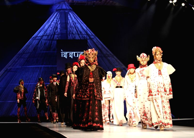 Ho Chi Minh City: Models present creations of Thai designer Roj Singhakul during the Vietnam International Fashion Week 2014 in Ho Chi Minh city, Vietnam, Dec. 2, 2014.