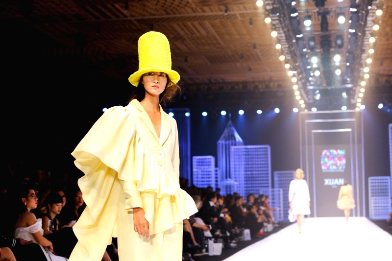 HO CHI MINH CITY (VIETNAM), April 25, 2017 A model presents a creation of Vietnamese designer Xuan Thu on the first day of the Vietnam International Fashion Week 2017 in Ho Chi Minh City, ...