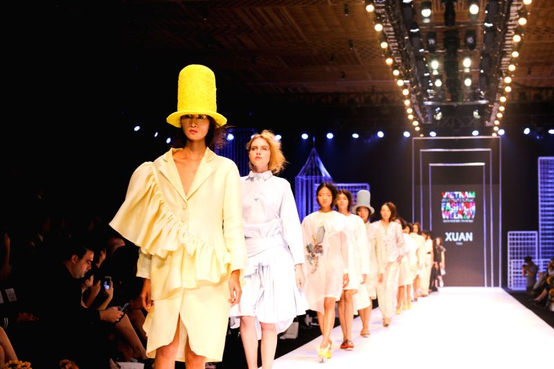 HO CHI MINH CITY (VIETNAM), April 25, 2017 Models present creations of Vietnamese designer Xuan Thu on the first day of the Vietnam International Fashion Week 2017 in Ho Chi Minh City, ...