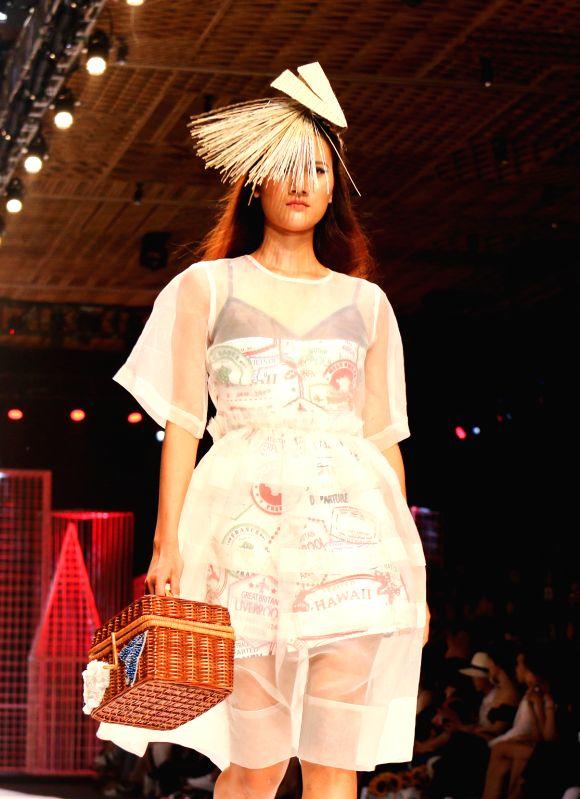 HO CHI MINH CITY (VIETNAM), April 26, 2017 A model presents a creation of Vietnamese designer Devon Nguyen during the Vietnam International Fashion Week 2017 in Ho Chi Minh City, Vietnam, ...