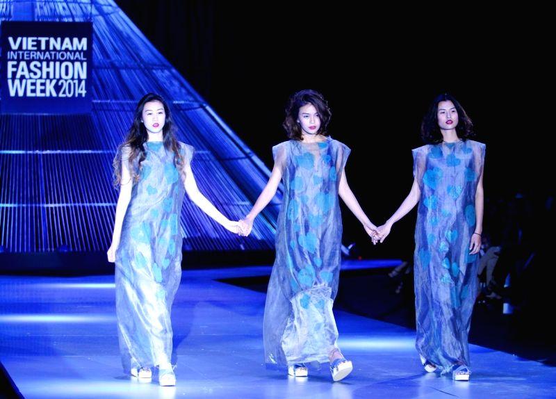 Ho Chi Minh city (Vietnam): Models present creations of Vietnamese designer Li Lam during the Vietnam International Fashion Week 2014 in Ho Chi Minh city, Vietnam, Dec. 4, 2014. (Xinhua/Nguyen Le ...