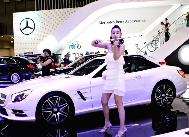 Ho Chi Minh city: Violin artists perform at Mercedes-Benz booth during the Vietnam Motor Show 2014 in Ho Chi Minh city, Vietnam, Nov. 19, 2014. The Vietnam Motor Show 2014, the biggest annual event ..