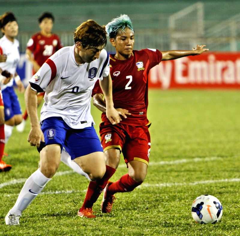 Park Eun Sun (L) of South Korea vies for the ball during the Group B match against Thailand at the 2014 Women's AFC Cup held at Thong Nhat Stadium in Ho Chi Minh