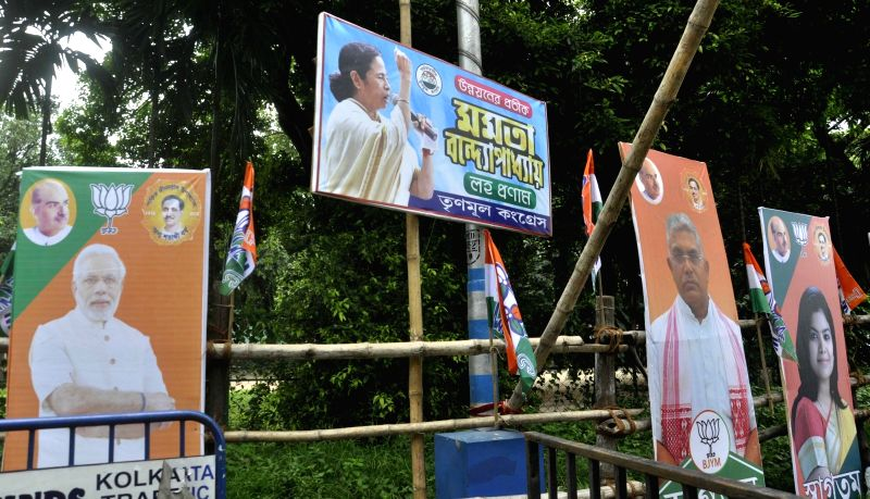 Hoarding set up displaying BJP leaders poster at Mayo Road during a preparation of BJP president Amit Shah's rally, in Kolkata, on Aug 10, 2018. - Amit Shah