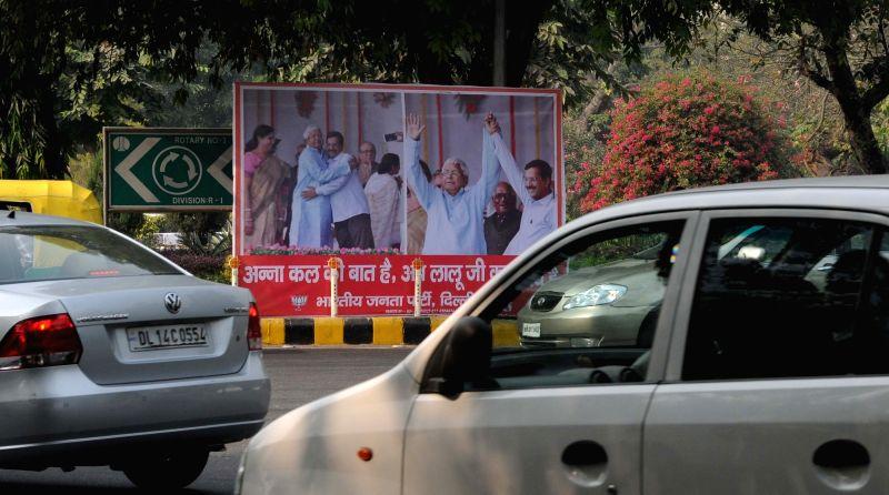 Hoardings of RJD supremo Lalu Prasad Yadav and Delhi Chief Minister Arvind Kejriwal set up by BJP in New Delhi, on Nov 23, 2015. - Arvind Kejriwal and Lalu Prasad Yadav