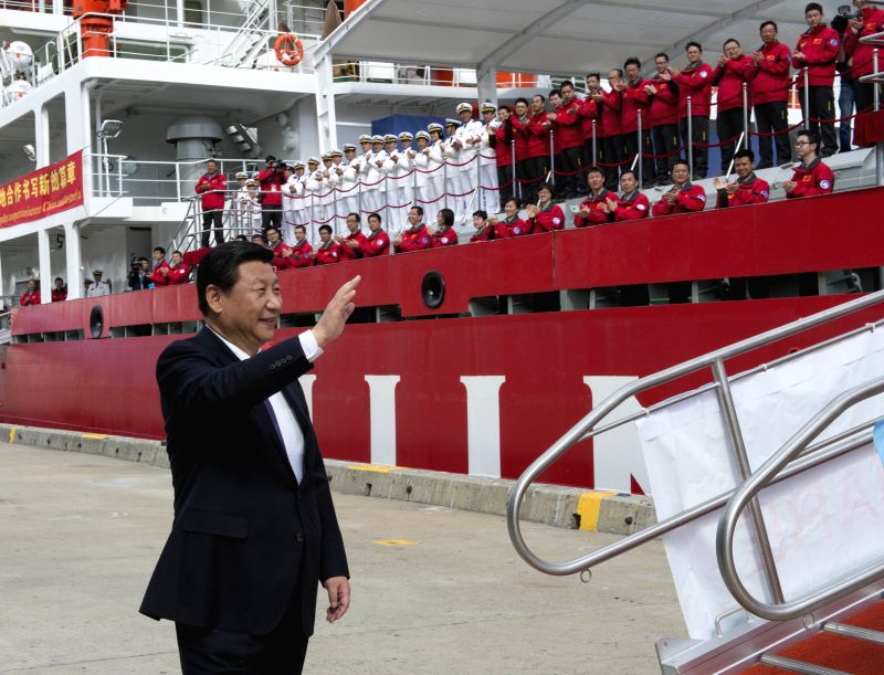 Hobart (Australia): Chinese President Xi Jinping waves to crew members of Chinese research vessel and icebreaker Xuelong, or Snow Dragon, in Hobart, Australia, Nov. 18, 2014.