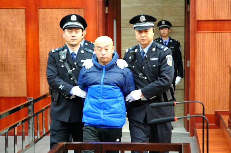Alleged serial killer Zhao Zhihong is escorted to stand trial for murder, rape, robbery and larceny at the Hohhot Intermediate People's Court in Hohhot, capital of ...