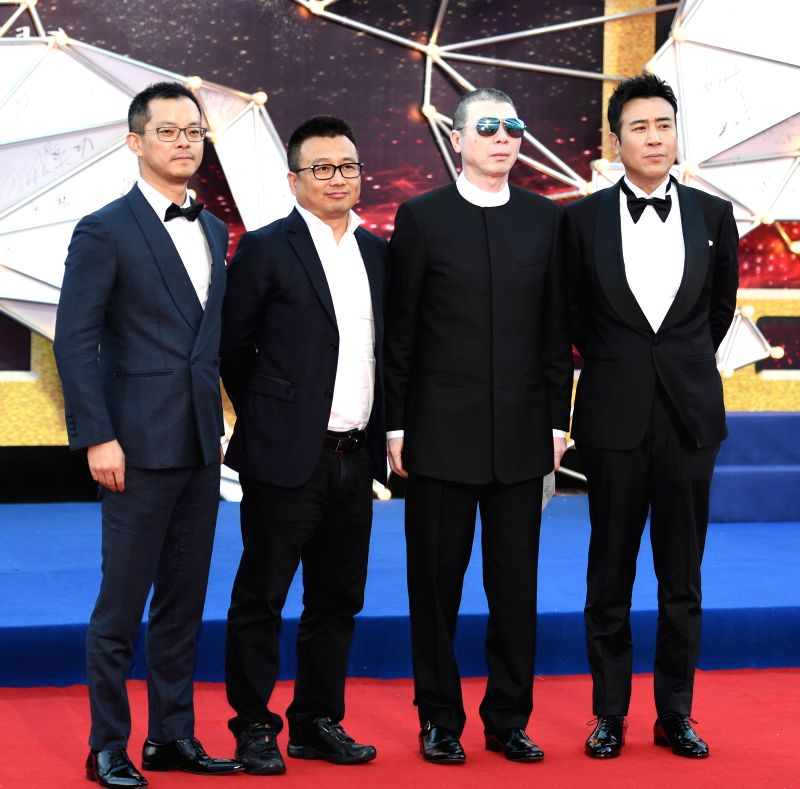 """HOHHOT, Sept. 16, 2017 - Cast members of the film """"I Am Not Madame Bovary"""" pose for pictures on the red carpet before the Awarding Ceremony of the 26th China Golden Rooster & Hundred ..."""