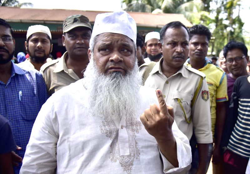 Hojai: All India United Democratic Front (AIUDF) chief Maulana Badruddin Ajmal shows his forefinger marked with indelible ink after casting vote during the second phase of Lok Sabha polls, in Assam's Hojai, on April 18, 2019.