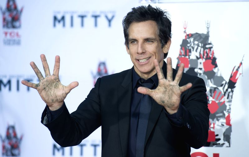 :HOLLYWOOD, Dec. 4, 2013 (Xinhua/IANS)U.S. actor Ben Stiller poses at his hand and footprint ceremony outside the TCL Chinese Theater in Hollywood, California, Dec. 3, 2013. (Xinhua/Yang Lei).