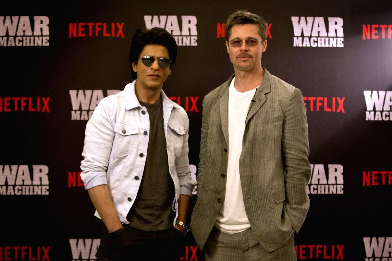 Hollywood Movie Star, Brad Pitt with Bollywood Movie Star, Shah Rukh Khan, at the Oberoi Trident Towers in Mumbai, India, to promote Brad Pitt?s newest fi - Rukh Khan