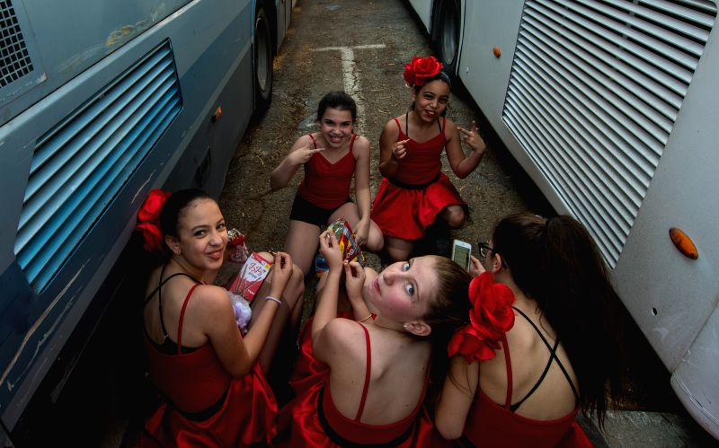 HOLON (ISRAEL), March 6, 2015 Young performers rest after the Adloyada Holon Purim Parade 2015 in Holon, central Israel, on March 5, 2015. The festive parade was held to celebrate Purim ...