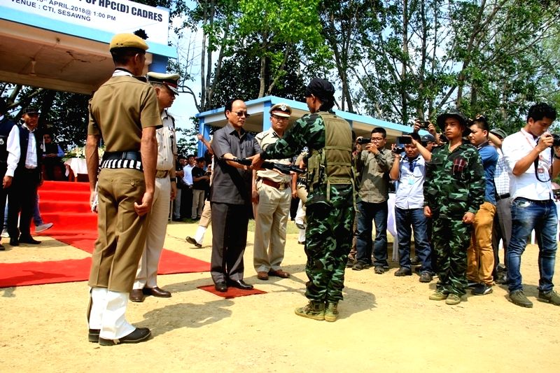 Home Minister R. Lalzirliana receiving arms from a cadre of Hmar People's Convention-Democratic (HPC-D). He is among the 114 surrendered HPC-D terrorists Friday laid down arms and ammunition before ... - R. Lalzirliana