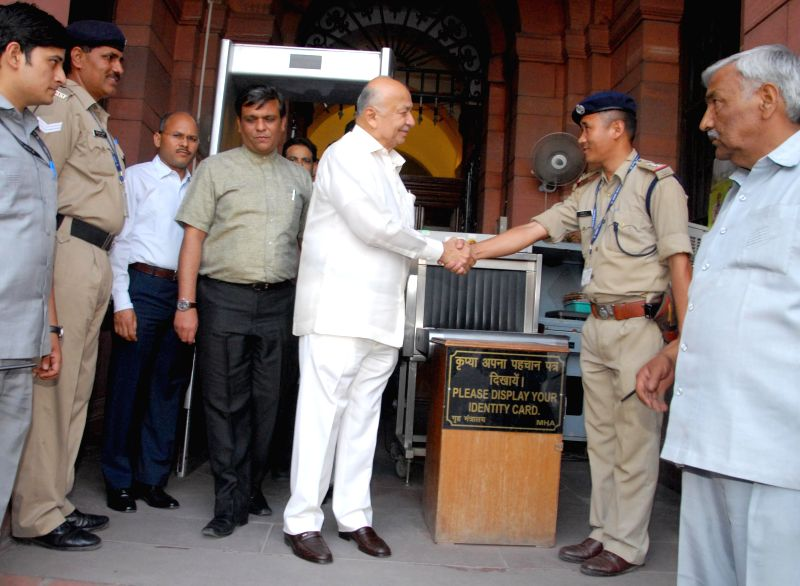 Home Ministry staff sees off Union Home Minister Sushilkumar Shinde in New Delhi on May 15, 2014.