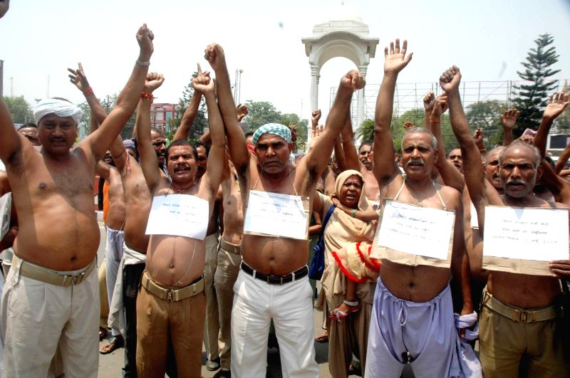 Homeguards stage a demonstration to press for their demands in Patna on May 11, 2017.