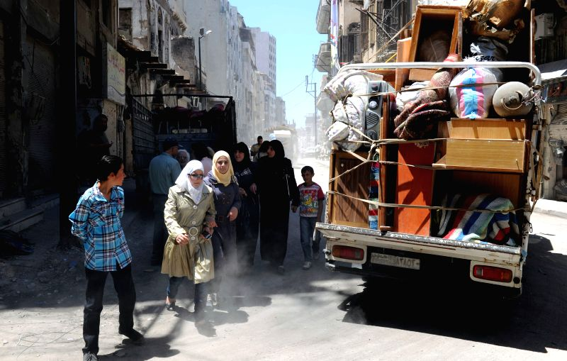 People return to check their houses in the old city of Homs, Syria, May 15, 2014. The war-torn old city of Homs are left empty of arms and armed rebels but debris and ..