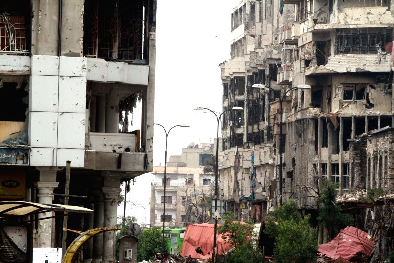 Photo: Damaged buildings are seen in the old city of Homs in central Syria on May 8, 2014, after the evacuation of opposition fighters on Wednesday. A total of 968 ...