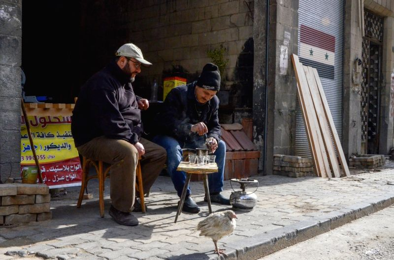 HOMS (SYRIA), Jan. 29, 2018 Rabea Sahloul (L) sits in front of his workshop with his friend in Hamidiyeh neighborhood in the old part of Homs, Syria, on Jan. 21, 2018. It wasn't easy for ...